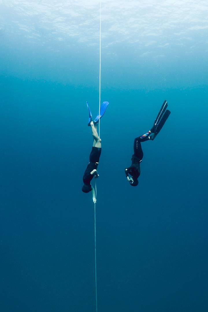 Freediver and freediving instructor descending
