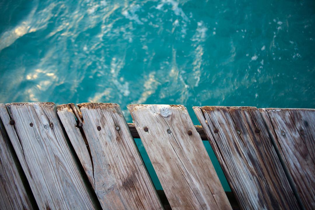 Jetty over turquoise Caribbean Waters, Roatan, Honduras